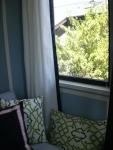 Curtains from  Ikea.  Embellished with navy blue grosgrain ribbon.  Trellis pillows and curtains sewn by Ana Zucconi.