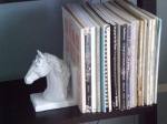 Horse bookend ....was a yucky brown colored wood that was spray painted white. Looks great holding up all The Partner's sheet music.